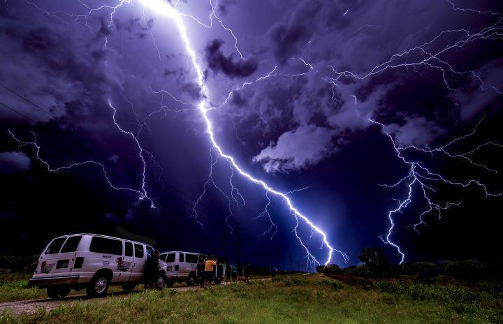 Lightning illuminates tour vans