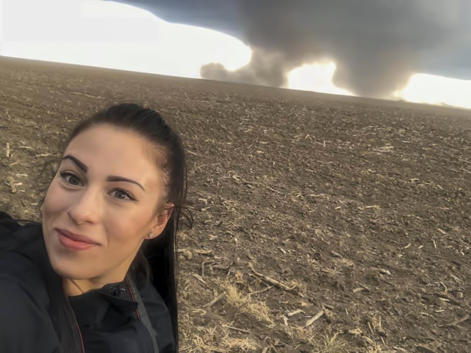 Ashleigh in front of twin tornadoes