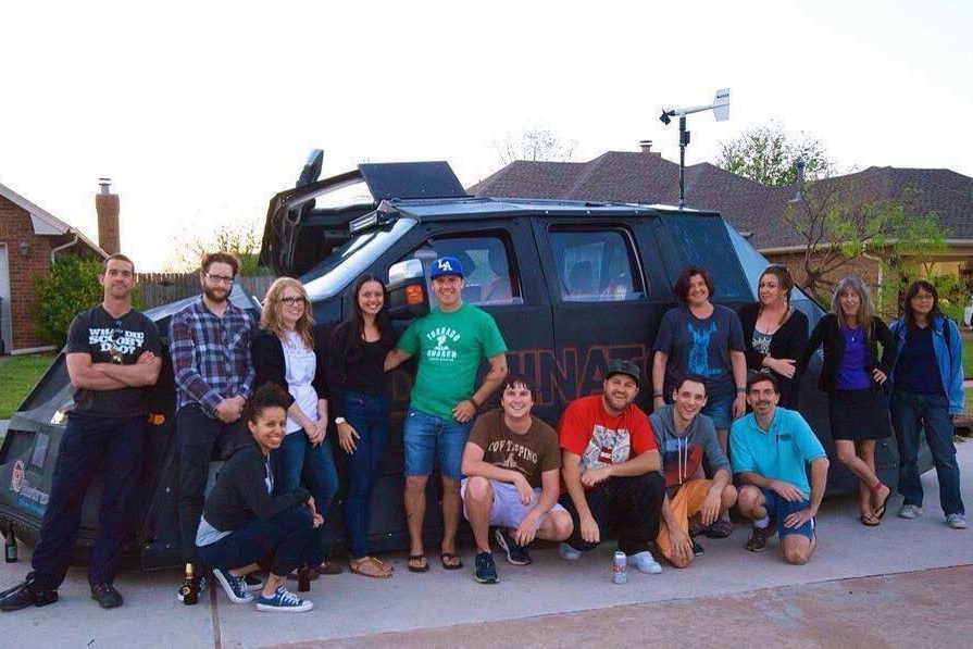 Tour guests in front of the Dominator